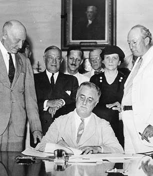 FDR signs Social Security Act (1935)